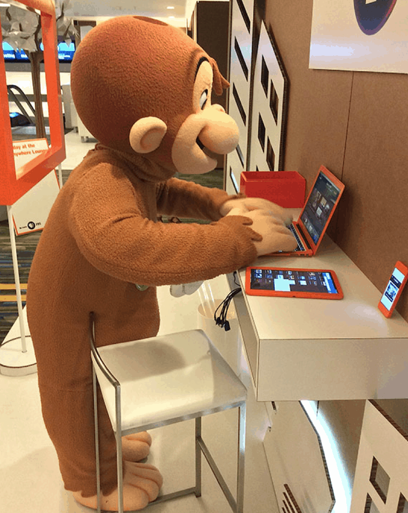 Curious George checks out the PBS video app in the PBS Anywhere pop-up lounge in San Francisco.